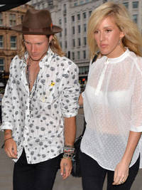 The only McFly bachelor! Dougie Poynter arrives to Danny Jones' pre-wedding dinner on arm of Ellie Goulding