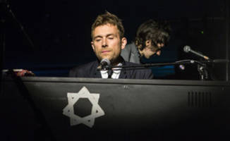 Damon Albarn performs for robots in Japan